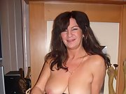 Sexy brunette wife shows off her big tits and fishnet stockings