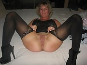 Mature blonde wife shows off her shaved pussy and big tits