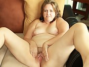 Chubby wife showing off her tiny thong and hairy pussy for the camera