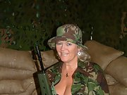Mature blonde dressed in fatigues show off her impressive body