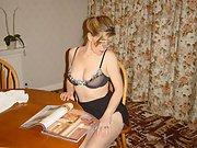 Blonde wife preforms a seductive striptease down in livingroom