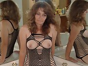 Mature brunette shows her pretty tits and pussy in lingerie