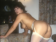 Yvonne in stockings and suspenders showing you her ass