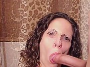 Sexy brunette wife gives a blowjob and gets covered in cum