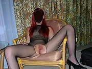 Horny slut spreads her pantyhose open and masturbates on chair