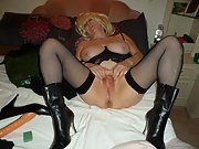 Voluptuous MILF loves wearing lingerie and playing with her wet pussy