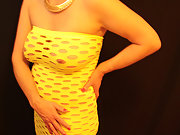 MILF In Little Yellow Dress Who Just Loves Showing Off What She has