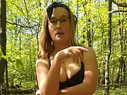 My wife undressed for you in the woods, you can watch her tits and pus