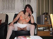 Mature brunette shows her sexy body and gives blow job