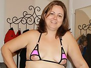 Wife shows off her micro bikini and hairy pussy for all