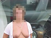 Mature wife exposes her big boobs in public
