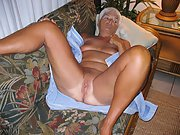 Granny Sandy O naked and rubbing her pussy for your enjoyment.