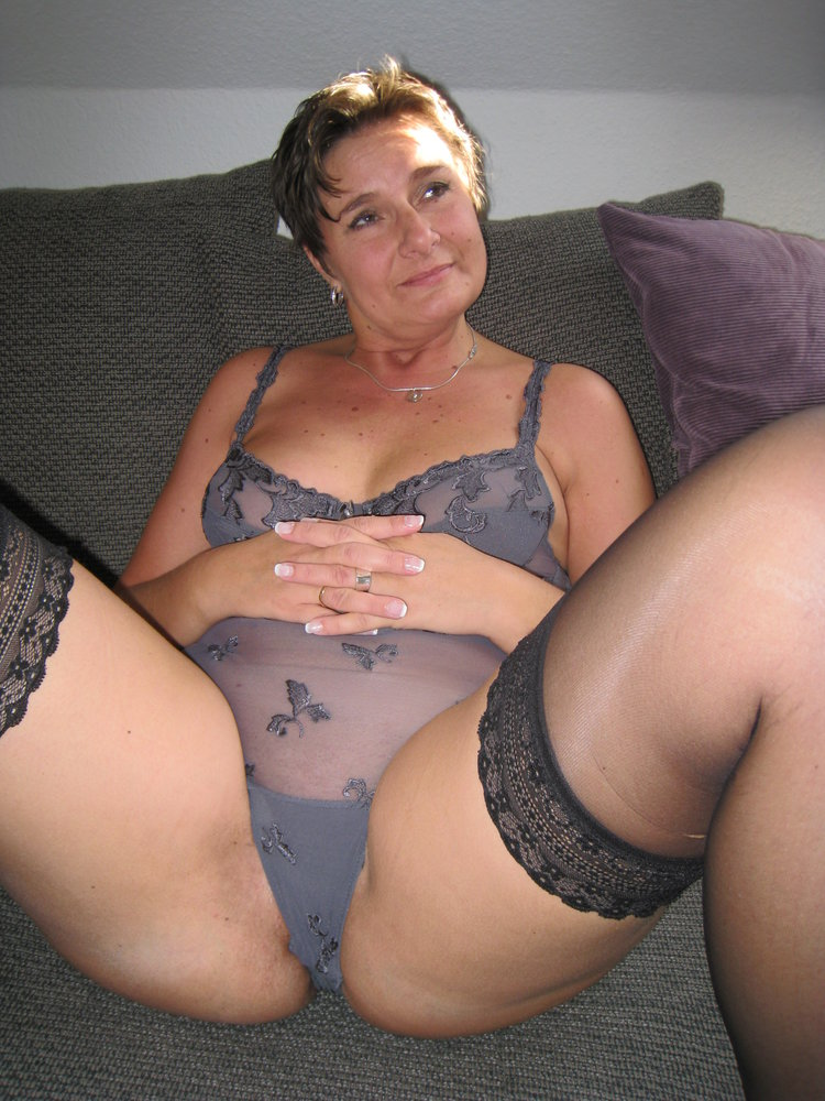 Thick mature getting dressed