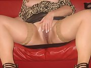 Sexy brunette wife wearing tan stockings fingers her shaved pussy