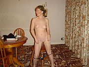 Blonde wife poses naked at the kitchen table
