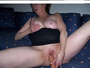 Mature wife teases her pussy with a dildo