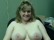 Blonde wife shows her huge jugs and spreads her pussy