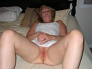 Mature blonde babe loves to show her bare wet pussy