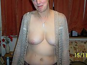 Mature wife with big tits pleasures herself with a dildo and cock