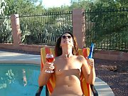 Good looking brunette wife plays with herself by the pool