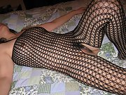 Asian milf in fishnet body suit shows off her sexy body