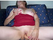 Mature blonde wife in red lingerie masturbates on chair