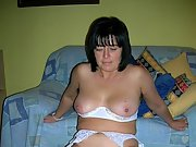 Mature wife poses naked and shows her hairy pussy