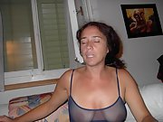 Chick drinks wine and wears transparent lingerie showing her tits