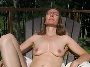 Old blonde wife sun bathing naked in a lawn chair