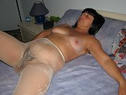 Mature Italian wife poses nude in her full body stocking