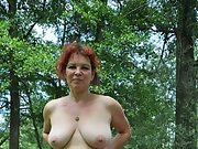Sexy MILF  bbw red head poses nude in the forest