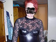 Beautiful redhead loves to wear leather lingerie and show pussy