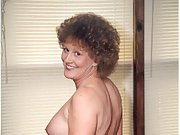 Curly haired brunette loves to show her pretty tits