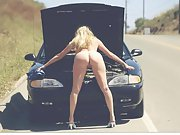Horny blonde wife poses naked outside on the road