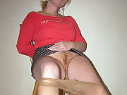 Mature red headed wife shows off her hairy pussy while wearing stockings