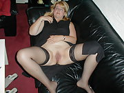 Hot wife on the couch playing with her pussy using dildo