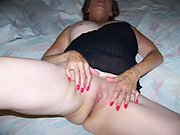 Mature wife takes a fake cock in her mouth and pussy