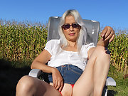 Blondie mature wife flashing her tits and pussy in public