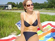 Hot brunette gets a tan in her skimpy bikini