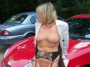Blonde wife shows off her big tits as she poses in front of her car