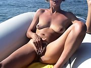 Mature brunette loves to have fun and masturbate at sea