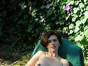 Summer strip outdoors in the back garden wearing just lingerie