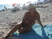 This blonde mature wife gets naked at the public beach