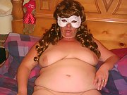 Sexy bbw wife wearing a white mask gets naked for camera