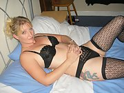 sexy blonde wife poses in lingerie and bare tits and gives me blowjob