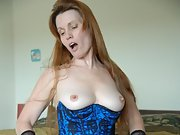 Horny red headed wife shows off her sexy body in lingerie