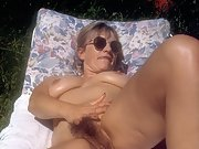 Yvonne gets naked on her sunbed and opens her legs to show her pussy