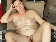 Chubby wife shows off her body and hairy pussy at home