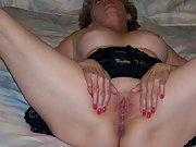 Mature blonde wife uses a dildo and fingers in her shaved pussy