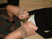Sexy wife shows off her stockings as she masturbates on the couch